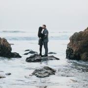 Couple near ocean getting married overseas