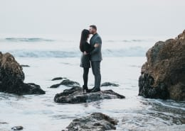 Couple near ocean getting married overseas